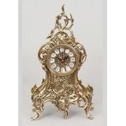 Часы с завитком золотистый 33х16см.