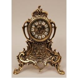 Часы с завитком половинки золото 32х25см.