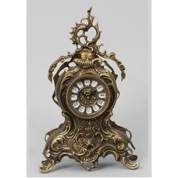 Часы с завитком 35х21см.