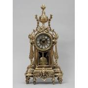 Часы с маятником 44х21см.
